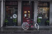 photograph of bicycle in front shop front
