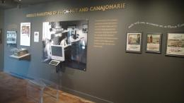 History and art exhibit with images, artifacts, and text on the wall